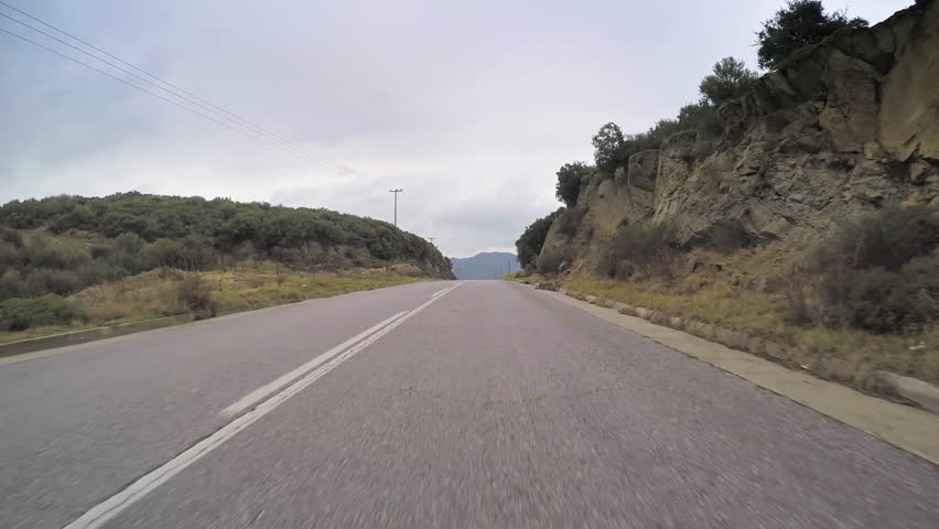 POV travel rural scenery car vehicle drive countryside road cloudy sky point of view  - 4K stock footage clip