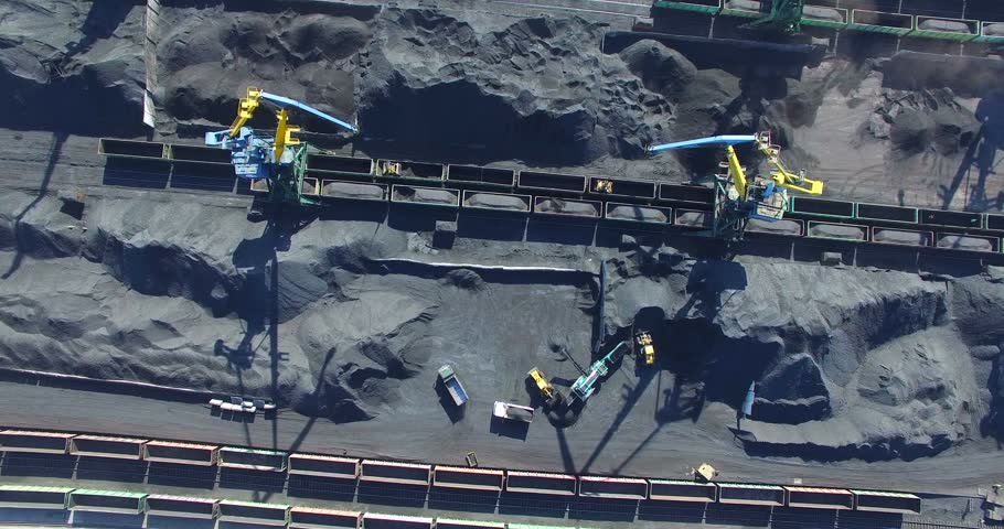 Flying above the place where the coal is being loaded into bulk cargo ship by big cargo cranes. Nakhodka bay, town of Nakhodka, the Far East of Russia. Aerial. | Shutterstock HD Video #15596035