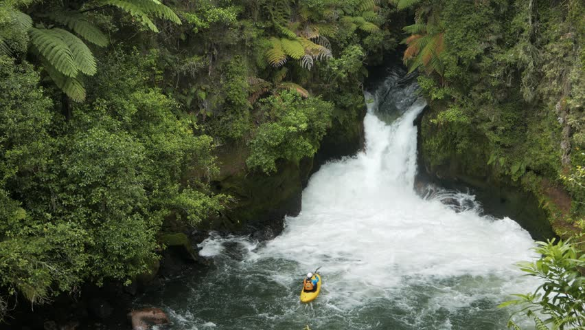 ROTORUA, NEW ZEALAND- DECEMBER, 2 2015: an inflatable raft is caught in new zealand's tutea falls on the north island of new zealand | Shutterstock HD Video #15597268