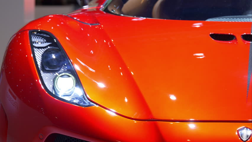 4K italian luxury red car / Dream sport vehicle in a motor show #15624322