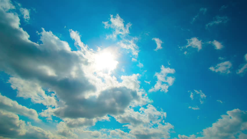 Clouds background. Cloudscape: clouds, sun rays, blue sky. Clouds timelapse, fast motion of clouds at blue sky in summer day. Universal cloudscape background, small clouds, bright blue sky background. | Shutterstock HD Video #15636193
