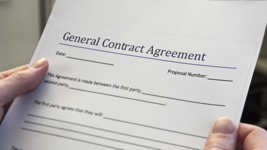 Blank General Contract Agreement Form In Male Hands. A contract is a voluntary arrangement between two or more parties that is enforceable at law as a binding legal agreement. - HD stock video clip