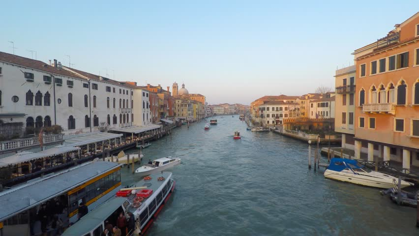 Venice, Italy - March 19, 2016: Grand canal of Venice with various canal traffic - Gondolas, Taxi-boats and VaporettoS (Water bus). - 4K stock video clip