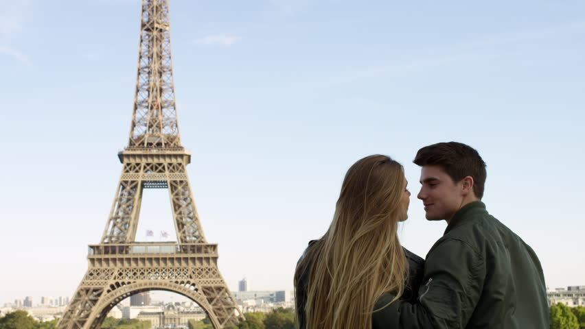 Couple enjoying each others company while visiting the Eiffel tower in Paris. Paris, France 42278 | Shutterstock HD Video #15686620