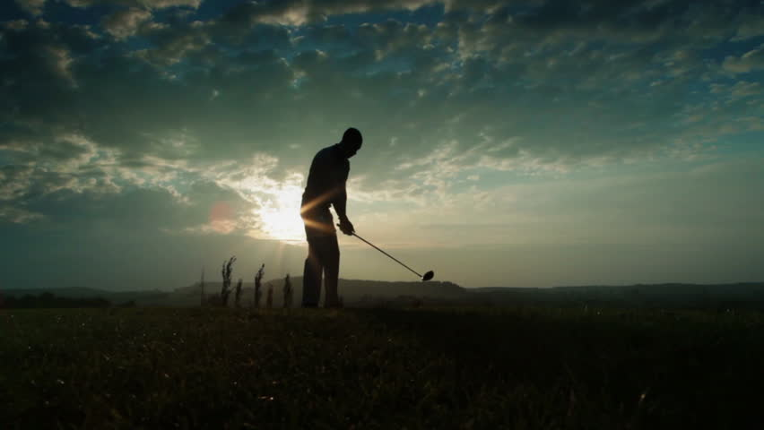 backlit golf drive slow motion - HD stock video clip