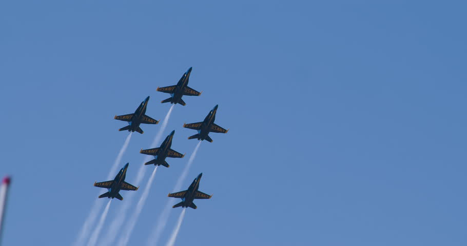NORTH KINGSTOWN, RHODE ISLAND - CIRCA JUNE 2014:  Navy Blue Angels demonstration team in F18 Hornet fighter jets performing during air show. 4K.