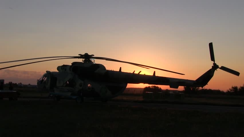 Helicopter silhouette at dawn. rising sun against the clear sky #15711541
