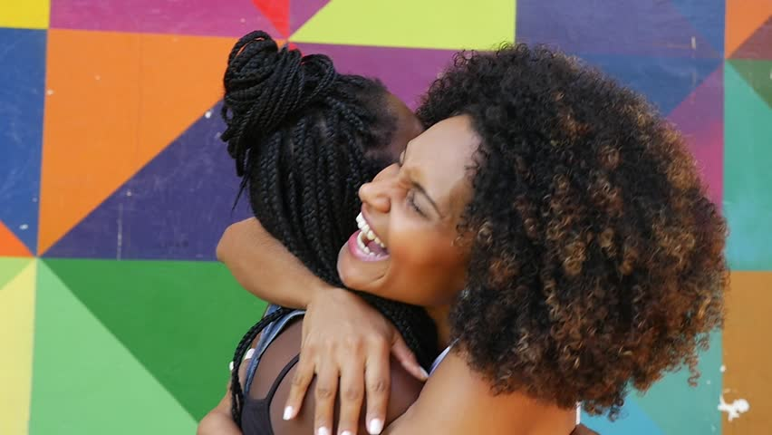 Women meeting and hugging on the park, slow motion  | Shutterstock HD Video #15714835