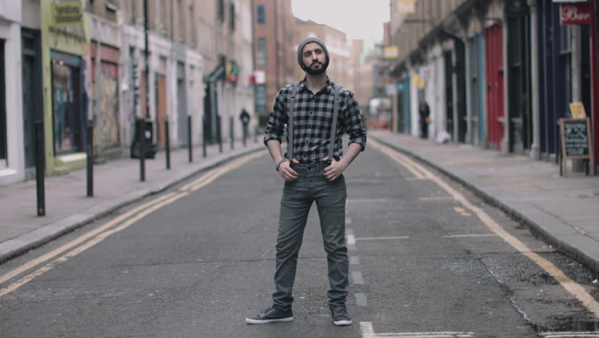 Hipster Male dancing in street looking to camera, London, England