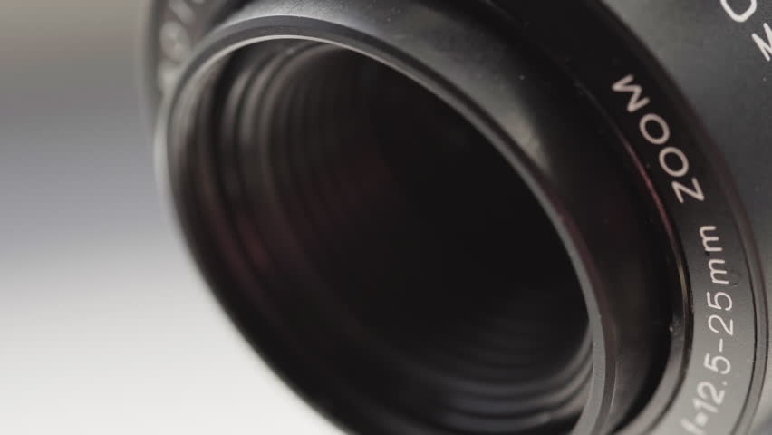 Vintage Movie Camera lens extreme close up UHD stock footage. A vintage lens in close up from a vintage movie camera circa 1977-1980 with a rotational camera move.