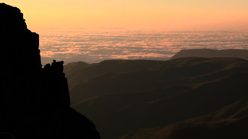Pan over mountains and clouds during sunset or sunrise  - HD stock video clip