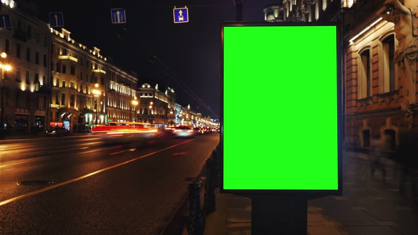 A Billboard with a Green Screen on a Busy Night Street.Time Lapse.   Shutterstock HD Video #15819577