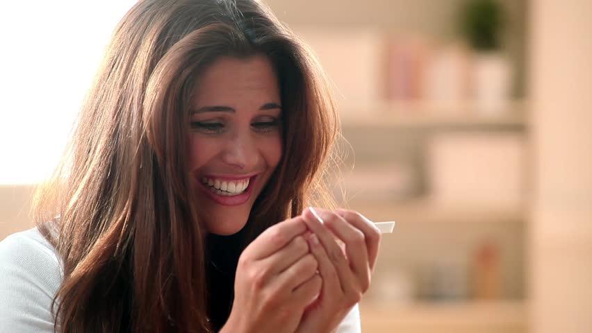 Woman using pregnancy test