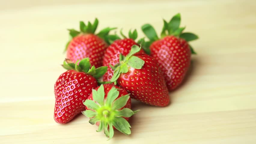 delicious strawberries rotation - HD stock footage clip
