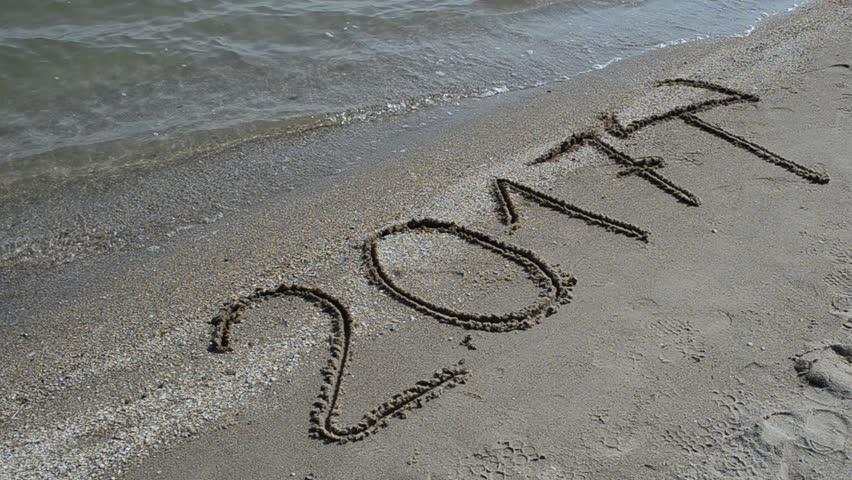Inscription 2017 on sand on the beach. - HD stock footage clip