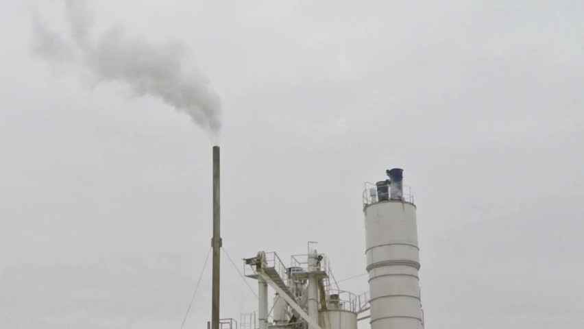 Smoke from chemical factory chimney over grey sky and clouds. Industrial air pollution. - HD stock footage clip