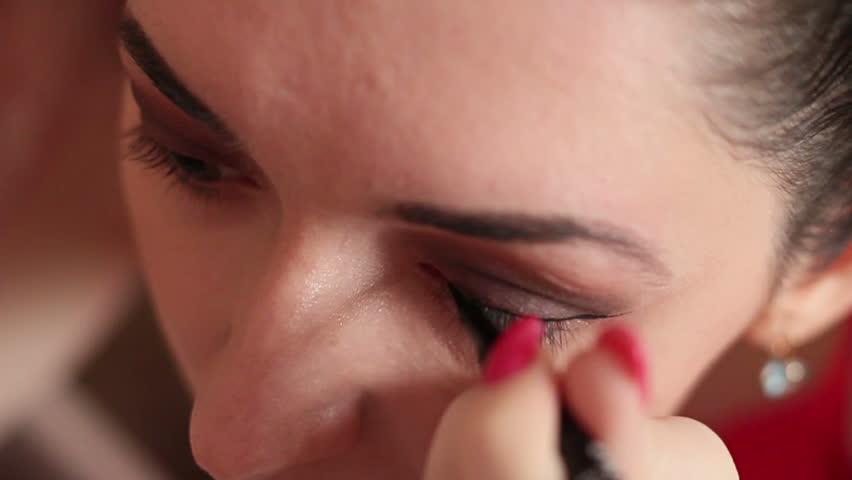 Girl Makes Gentle Makeup 6 - HD stock video clip