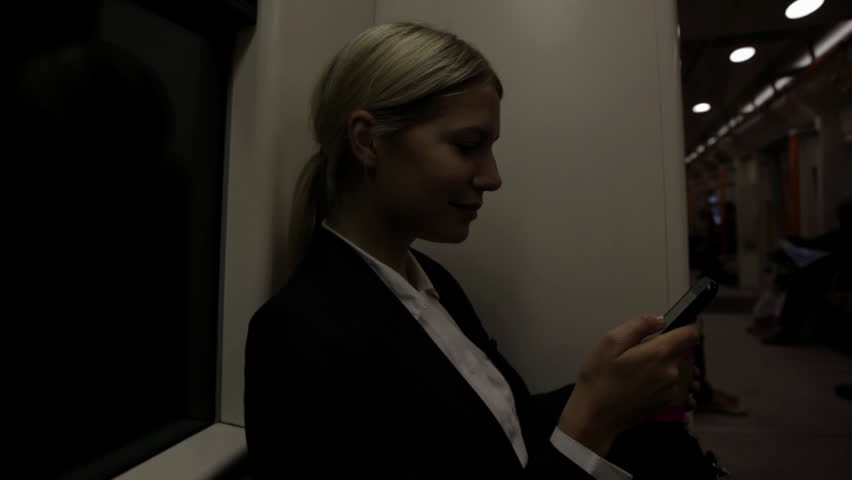 September 30, 2011: Businesswoman receiving text message on train - HD stock footage clip