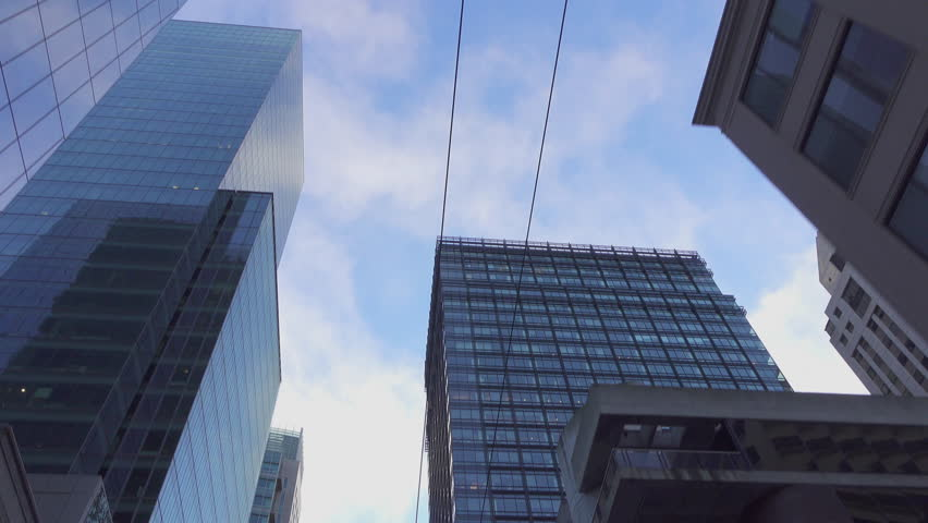SLOW MOTION CLOSE UP: Driving though busy San Francisco downtown business district with high glassy skyscrapers and big contemporary office buildings | Shutterstock HD Video #15875332