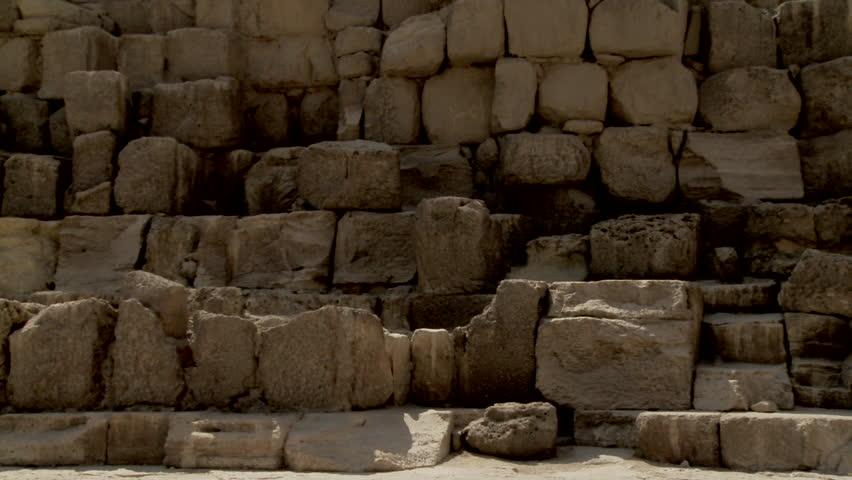 Panning low angled long shot of pyramids, Giza