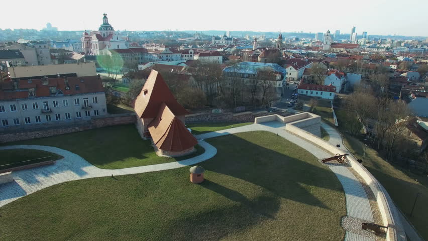 AERIAL. Scenic smooth flight above the Bastion of Vilnius city wall. Panorama of old town of Vilnius, Lithuania