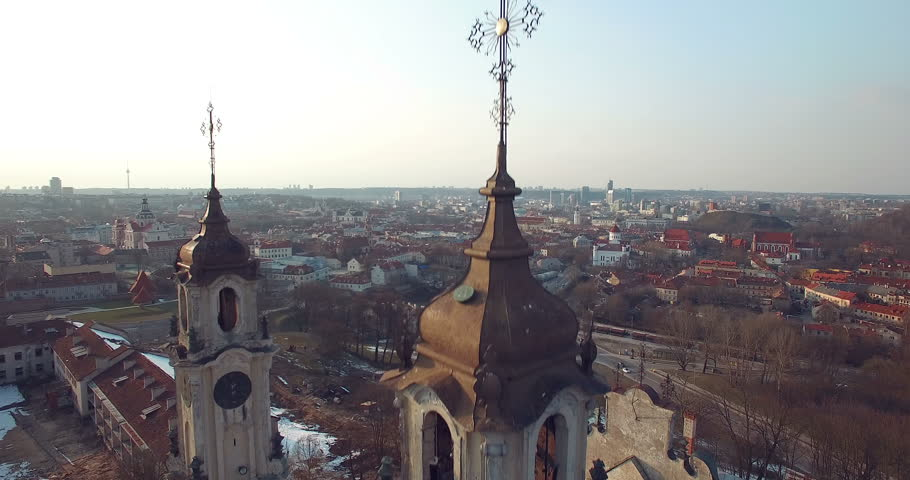 AERIAL. Smooth flight near Missionaries Church of Vilnius. Panorama of Vilnius old town. 4k