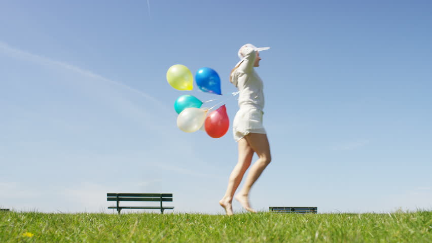 4k Young woman skips across the screen holding balloons | Shutterstock HD Video #16034920