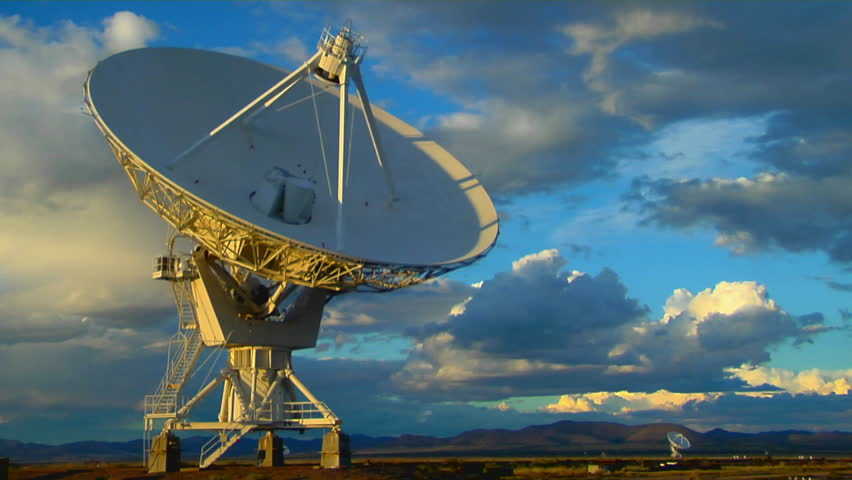A satellite dish moves in time-lapse against a beautiful sky - HD stock video clip