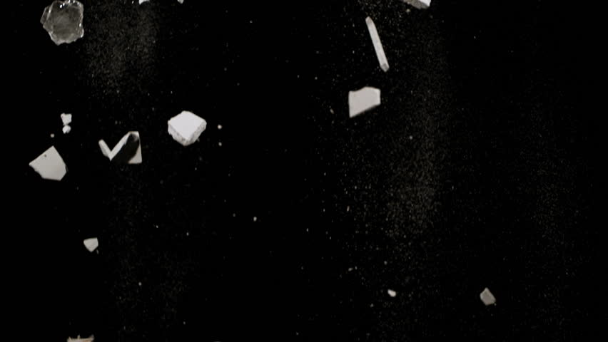 High quality motion animation representing various pieces of debris, falling in slow motion, on a black background. - HD stock footage clip