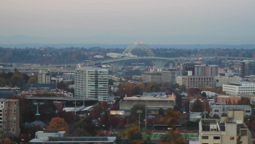 Fremont Bridge and Moonrise Over Portland Oregon Cityscape at Blue Hour in Fall and Autumn Season 1080p panning - HD stock video clip