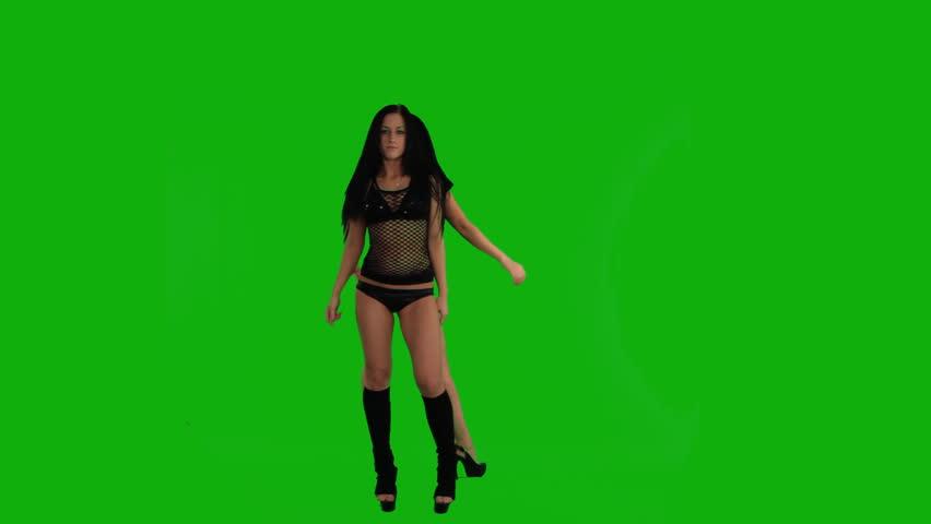 two beautiful girlsdancing against green screen  - HD stock video clip