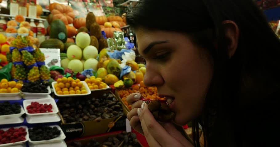 Woman on Fruit Market in Municipal Market (Mercado Municipal) in Sao Paulo, Brazil