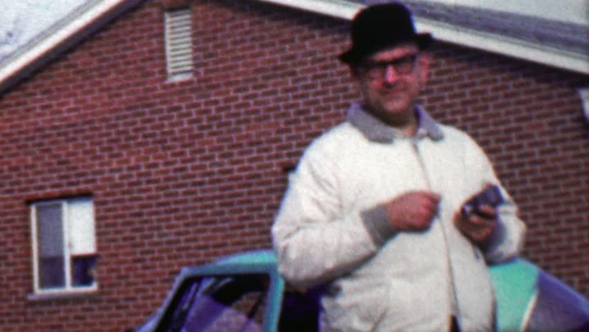 TOLEDO, OHIO 1958: Funny guy pranking camera man staring at hidden camera lens. - 4K stock footage clip