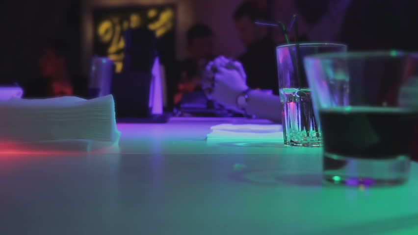 People relaxing with alcohol drinks, active atmosphere at nightclub bar counter - HD stock video clip