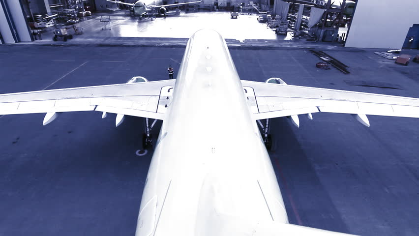 airline calls in the hangar - HD stock video clip