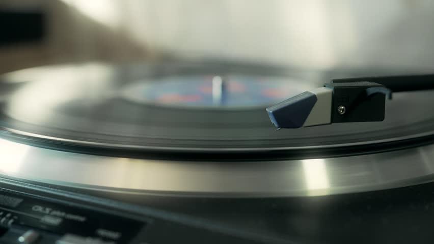 record player playing a vinyl record, start