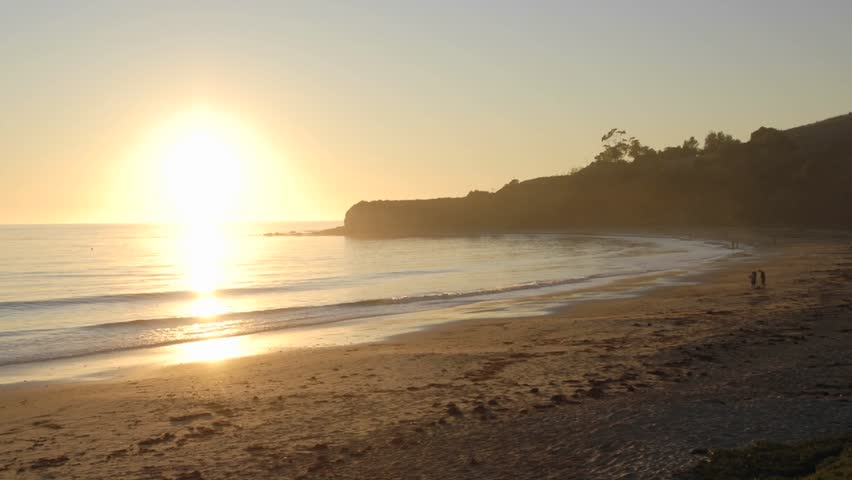Zoom in time lapse of sun setting over the Pacific Ocean at Refugio Beach State Park, California. - HD stock footage clip