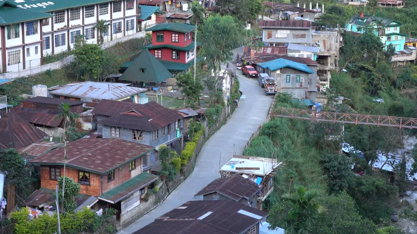 Banaue, Philippines - Jan 2, 2016: The rural road with many houses in Banaue, Philippines.