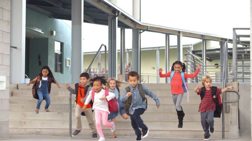 Young school kids jumping down steps as they leave school | Shutterstock HD Video #16356886