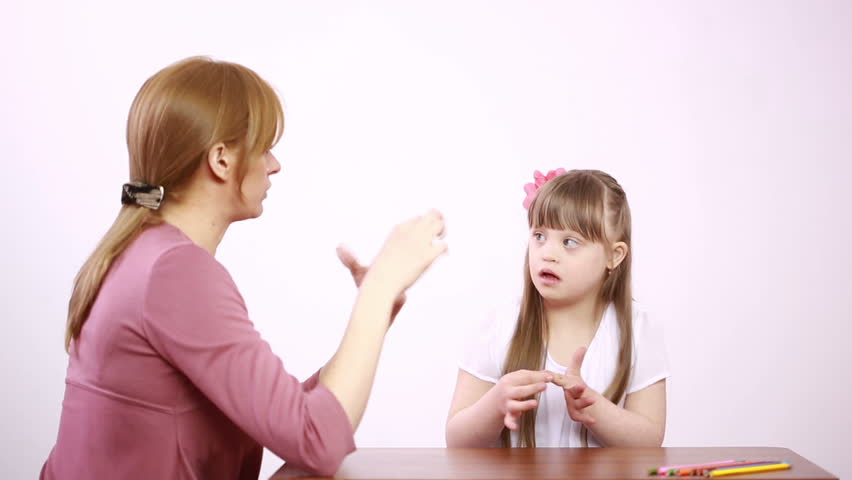 Downs Syndrome girl having speech therapy | Shutterstock HD Video #16413136