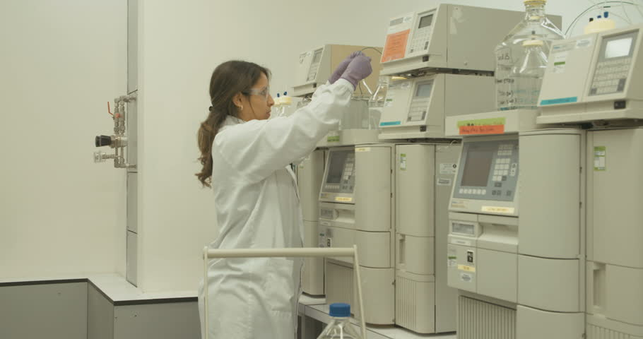 Researcher working with mass spectrometers in a pharmaceutical research lab | Shutterstock HD Video #16417699