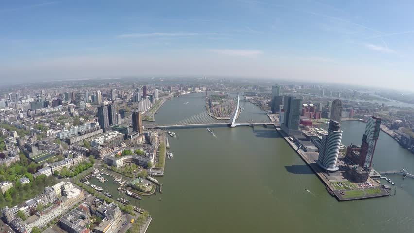 Aerial of Rotterdam city high altitude footage of Erasmus Bridge Erasmusbrug and business district right cityscape bird view city center large city in south of Holland great tourist attraction 4k #16455364