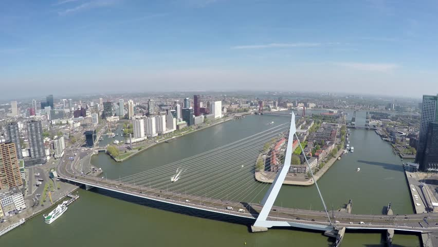 Aerial of Rotterdam city short footage flying near Erasmus Bridge Erasmusbrug modern architecture sunny day beautiful cityscape bird view of city center large city in south of Netherlands Holland 4k #16455373