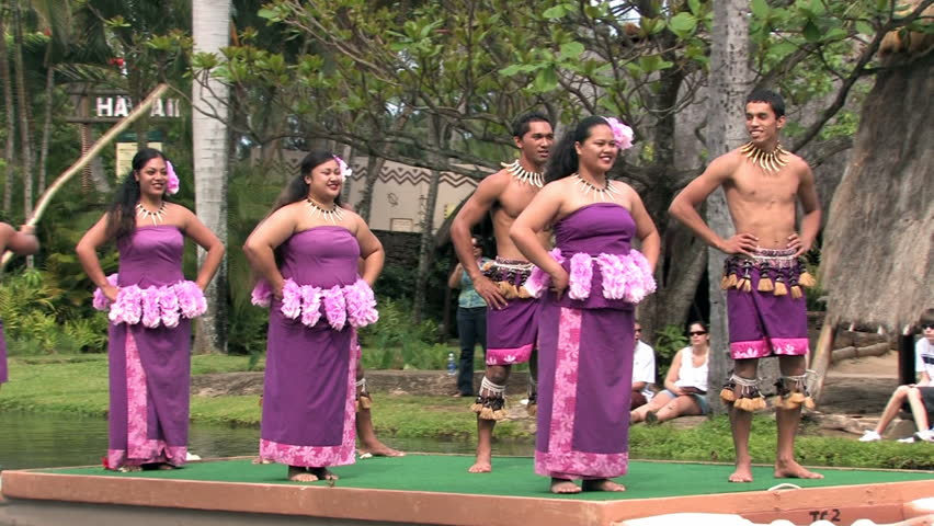 Polynesian Cultural Center in Laie Oahu Hawaii. Canoe show with dancers from Samoa. Demonstration for tourists in the main lagoon. Purple skirts on beautiful dancers. Water, lagoon and palm trees. - HD stock video clip