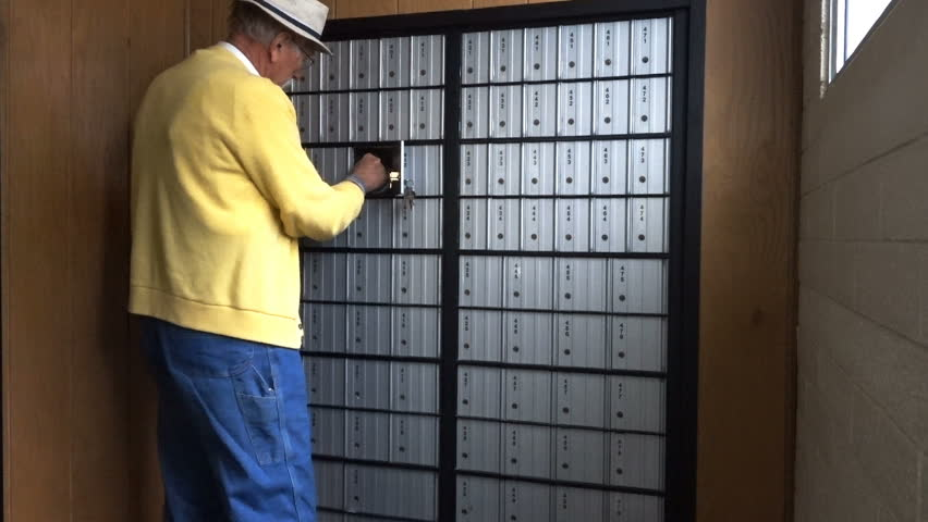 FOUNTAIN GREEN, UTAH - APRIL 2016: Older senior citizen man in yellow sweater, coveralls and fisherman hat with grey goatee getting mail from rural America Post Office Box. | Shutterstock HD Video #16482544