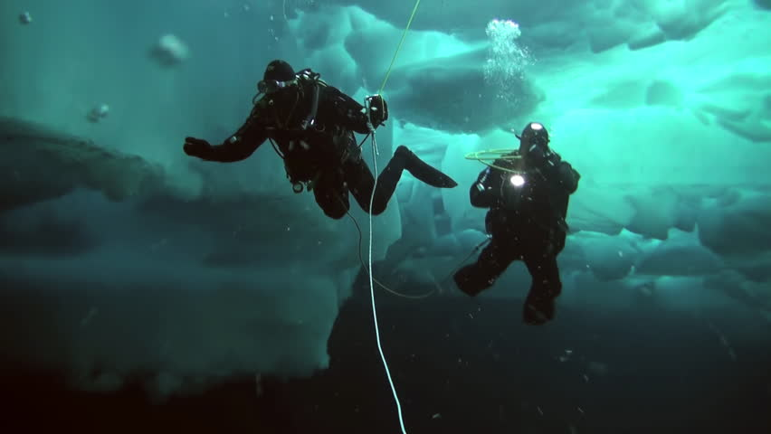 Unique extreme underwater shooting scuba dive beneath ice at geographic  North Pole in cold waters. Fantastic views of the lump of ice in water. ICE CAMP BARNEO, NORTH POLE, ARCTIC - APRIL 10, 2015 | Shutterstock HD Video #16524439