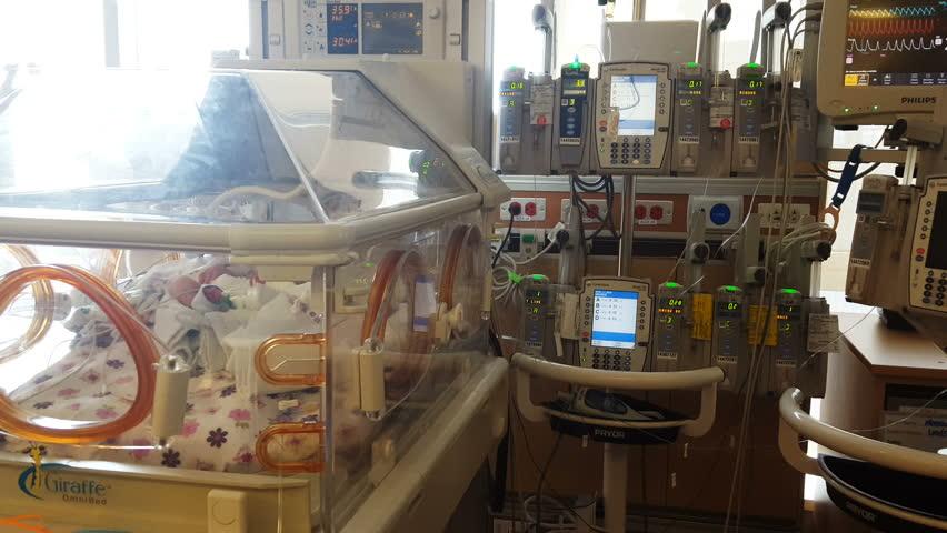 PROVO, UTAH - APRIL 2016: Neonatal Intensive Care Unit monitoring equipment monitors the vital sign of a premature infant in distress.   Shutterstock HD Video #16528120