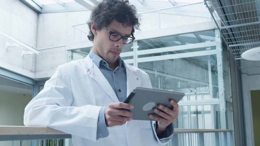 Latin Ethnicity Student of Medical School using Tablet Computer in Hallway. Shot on RED Cinema Camera in 4K (UHD). | Shutterstock HD Video #16547200