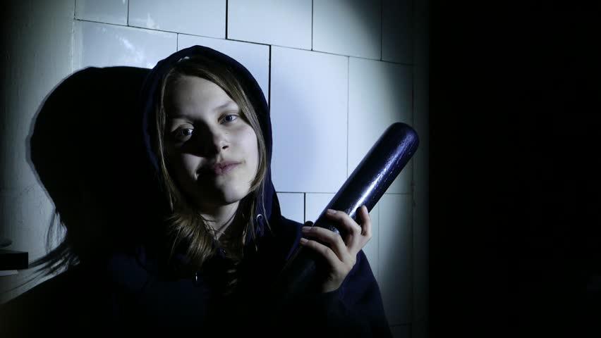 Criminal teen girl with baseball bat, young hooligan. 4K UHD.