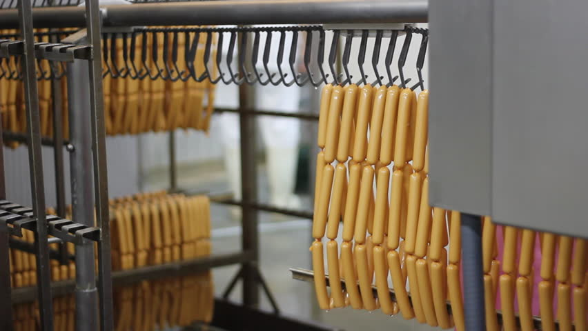 Production of hot dogs in a factory - HD stock video clip